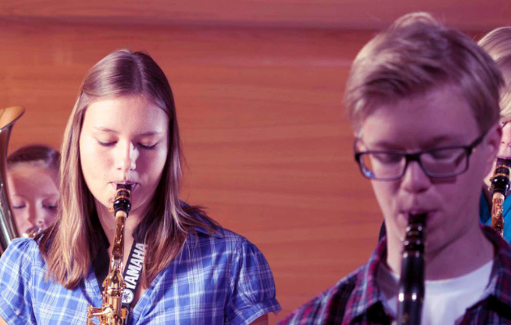 Group of students playing woodwind instruments.