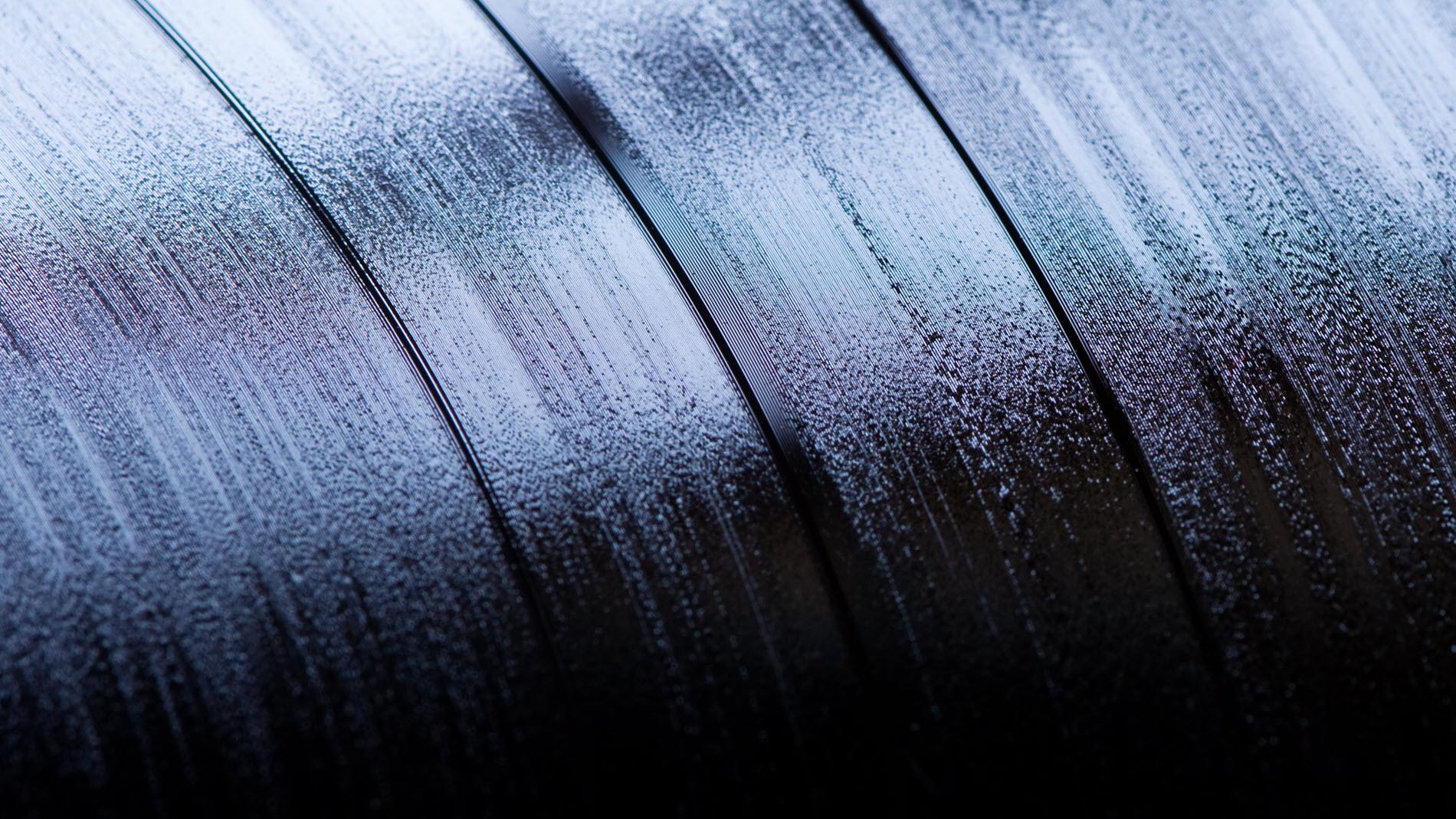 Closeup of vinyl record grooves.