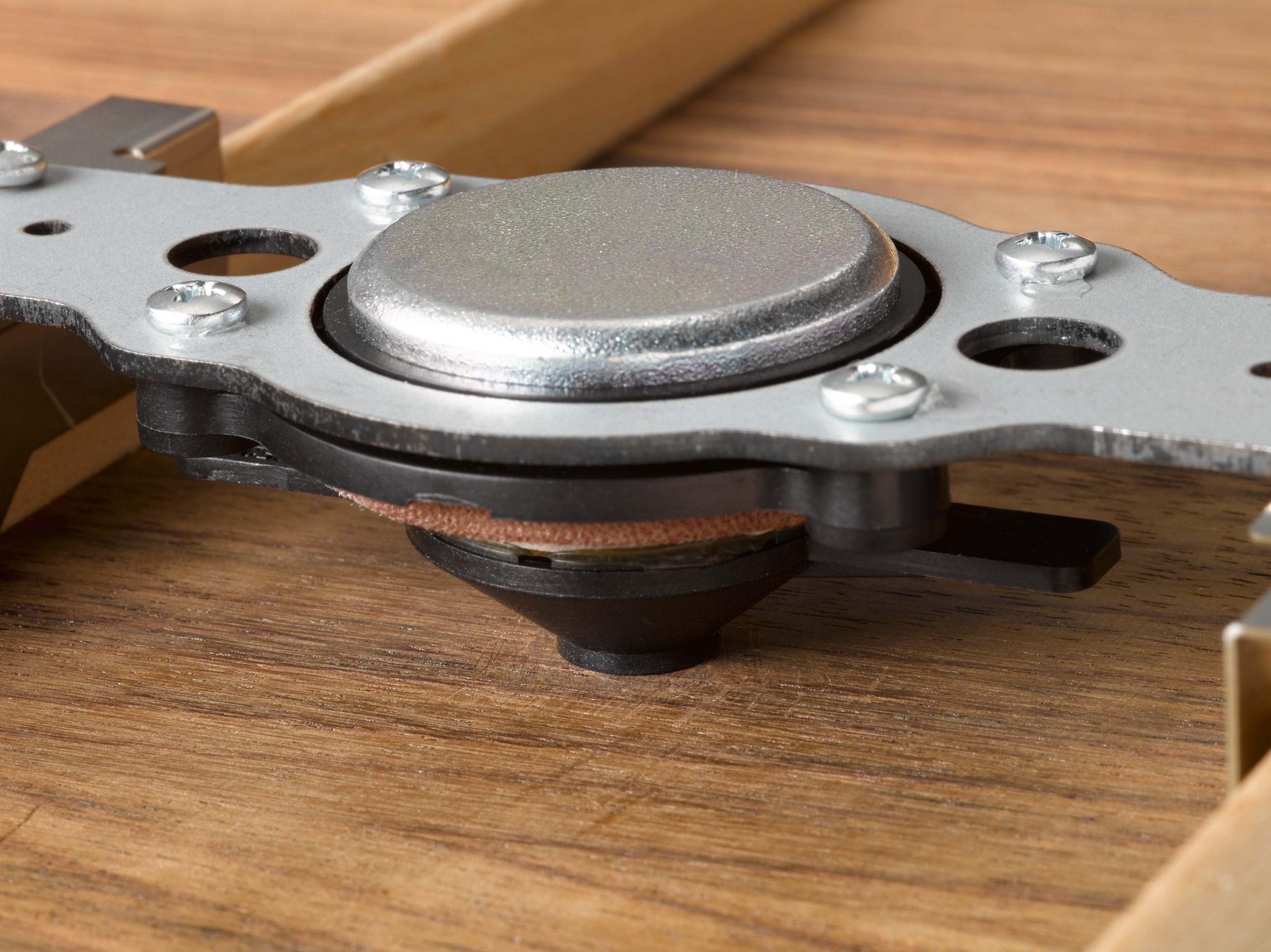 Closeup of small metal piece.