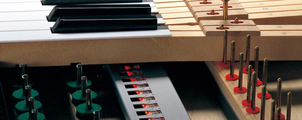 Closeup of sensors under the piano keys.
