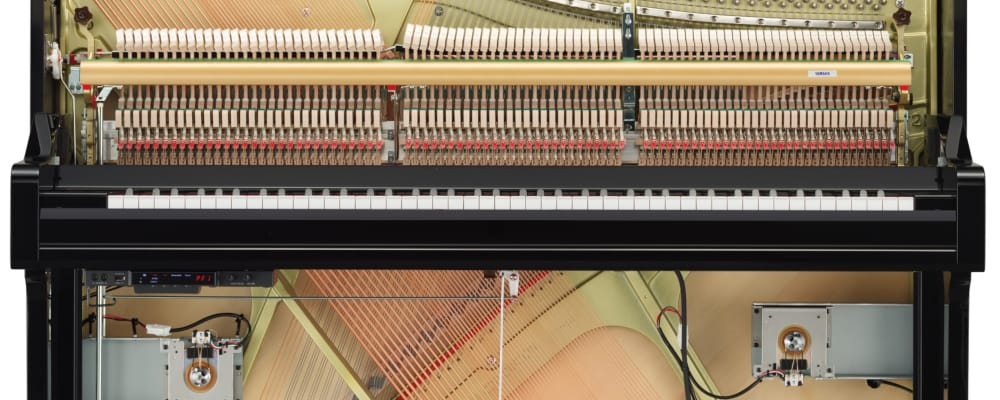 Diagram showing inner workings of hybrid upright piano.