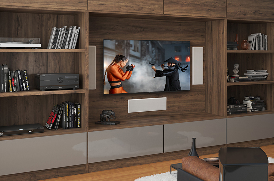 View of TV in a wall unit of bookcases.
