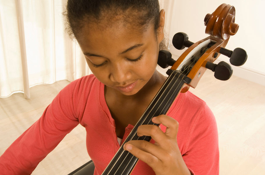Young girl playing a cello.
