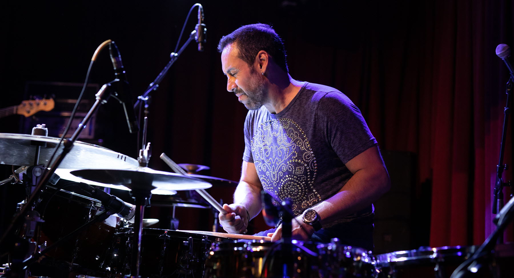 Man playing drums on stage.