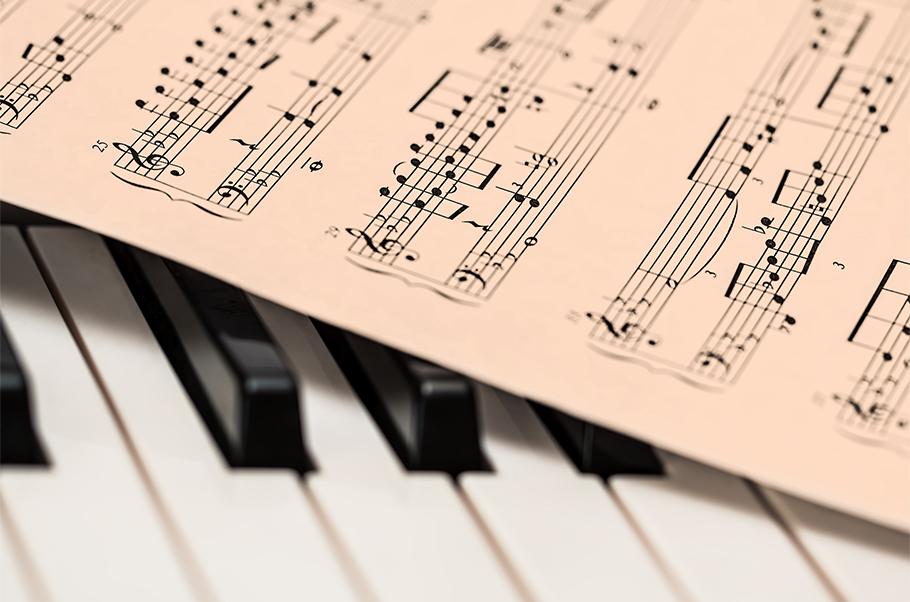 Sheet music on a piano keyboard.